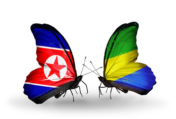 Two butterflies with flags North Korea and Gabon