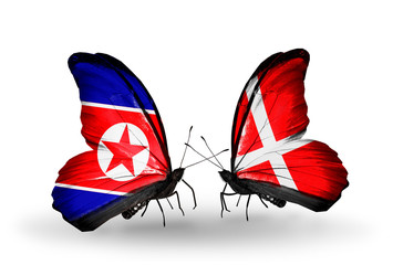 Two butterflies with flags North Korea and Denmark