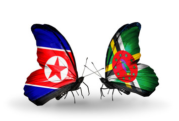 Two butterflies with flags North Korea and Dominica
