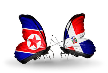 Two butterflies with flags North Korea and Dominicana