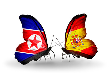 Two butterflies with flags North Korea and  Spain