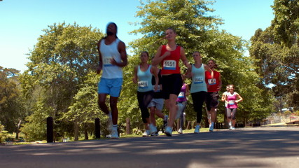 In high quality format happy people running race in park