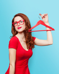Smiling redhead girl with hanger