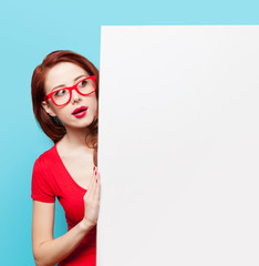 girl in red dress and glasses with white board