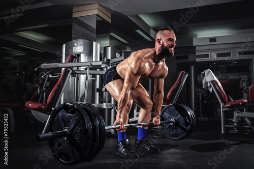 Muscular Man Doing Heavy Deadlift Exercise - 79523432