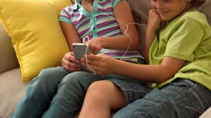 In slow motion two children listenning music