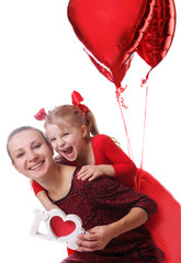 Mother and daughter with red word love and balloons