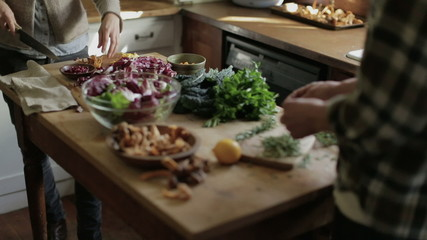Couple preparing ingredients for cooking in kitchen