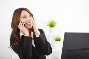 happy  businesswoman talking on the phone in the office