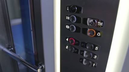 Clicking on the button in an elevator and lift movement