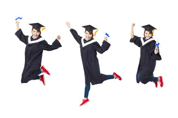Happy female student in graduate robe jumping against white back