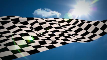 Checkered flag against blue sky