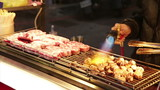 Vendor cooking beef with blowtorch at Taiwan Night Market  poster