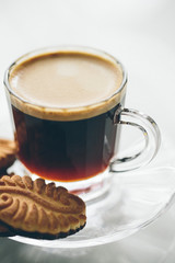 Coffee served with a crunchy biscuit