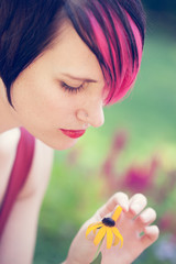Punk woman plucking petals