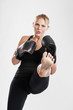 Female kickboxer kicking portrait