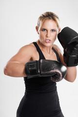 Female boxer punching portrait