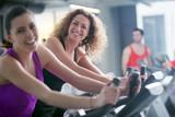 Fototapety Group of people running on treadmills