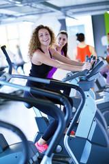 Group of people running on treadmills © .shock