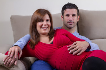 Close up view of a expecting happy couple