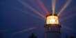 Leinwandbild Motiv Lighthouse Beams Illumination Into Rain Storm Maritime Nautical