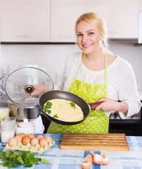 Positive girl with cooked omelet