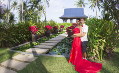 Couple in love in a tropical garden. Thailand