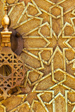 Detail of a brass door and knocker in Fez, Morocco