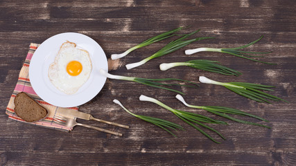 Egg , chives and black plate look like sperm competition,