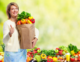 Woman with Vegetables over green background.