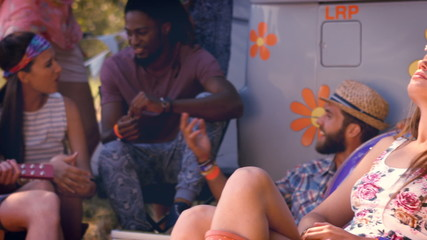 In high quality format hipsters having fun in their campsite