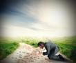 Businessman investigates the footsteps