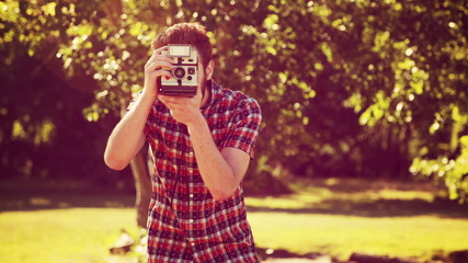In high quality 4k format handsome hipster with retro camera