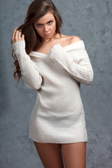 Beautiful young brunette woman in sweater