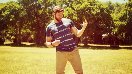 In high quality 4k format handsome hipster playing air guitar