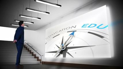 Businessman viewing education compass clip