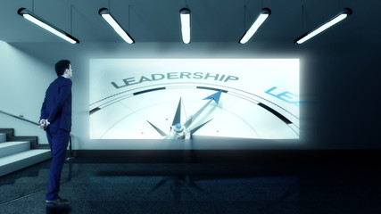 Businessman viewing leadership compass clip