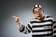 Leinwandbild Motiv Prison inmate in funny concept