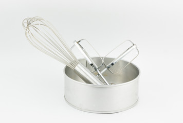 whisk and head of kitchen electric hand mixer in cake tray