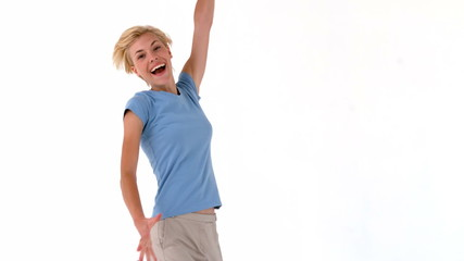 Blonde woman jumping and smiling