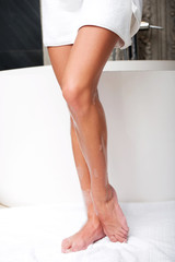 Beautiful woman legs in bathroom.