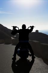 backlighting of a biker man.
