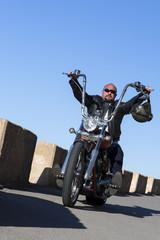 chopper motorcyclist driving.
