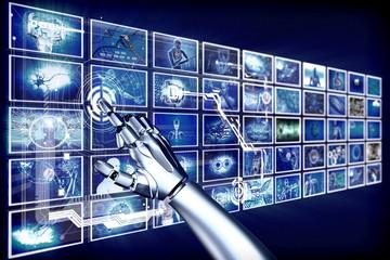 Robot arm pointing at hi-tech screens