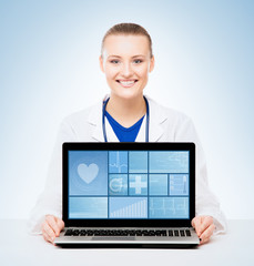 Young and professional medical doctor showing a laptop