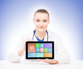 Young and professional woman doctor with a tablet