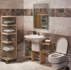 detail of a modern bathroom with sink, cabinet for towels and to