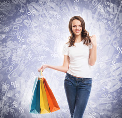 A young, attractive and happy shopping girl with bags