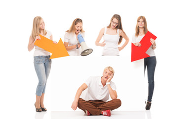 Group of teenagers with a white billboard isolated on white