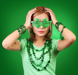 St Patrick's day Girl. Blonde woman with shamrock shaped glasses